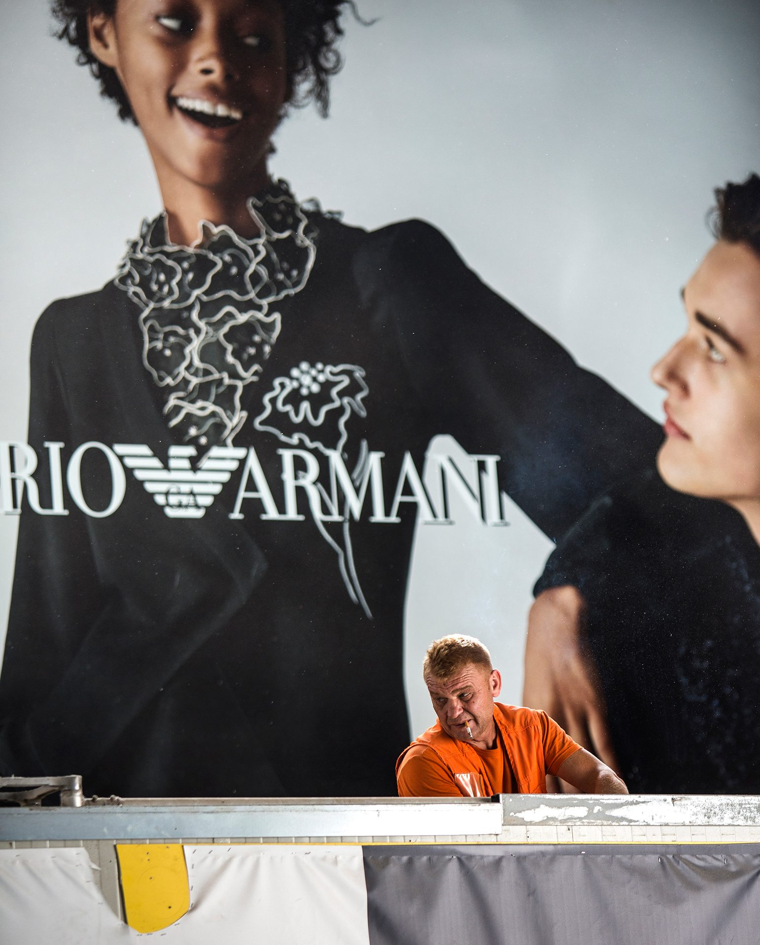 Armani, Rome, Italy, railway station, worker, smoker, smoking, emporio,