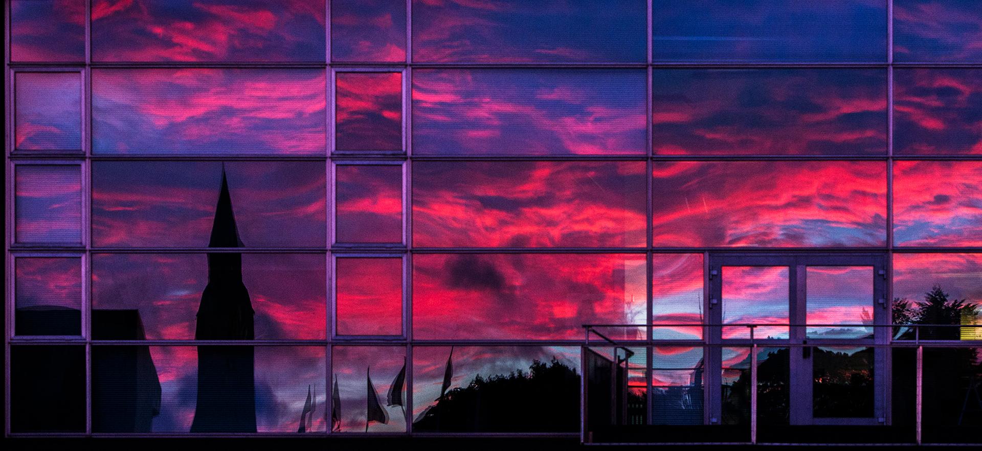 Reflection, Kansallismuseo, National museum of Finland, sunset in the glazing, Kiasma, contemporary art museum, Mannerheimintie, Helsinki