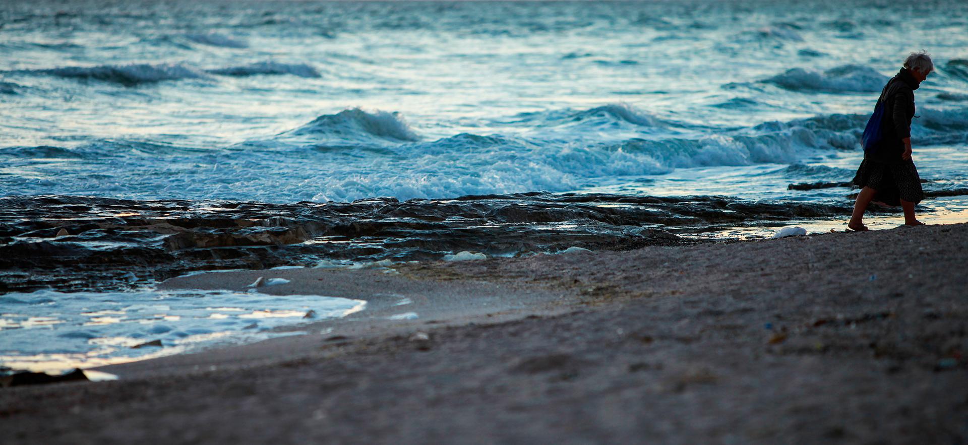 Caspian Sea, Aktau silhouette, woman, old woman at the sea shore